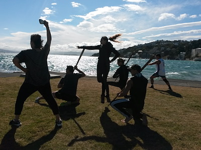 Caption: All Our Sons performers rehearse on the Wellington waterfront ahead of opening night. Image provided by Taki Rua Productions.