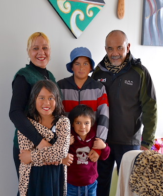 Photo caption: Minister for Māori Development, Hon Te Ururoa Flavell (far right) pictured with one of the nine whānau who have moved into the homes at Kohuhu papakāinga. (L-R): Joanne Thomas, Eddie Naicovi, Lucius Chase and Julius Moore.