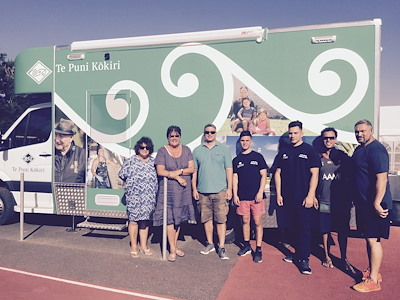 Michelle Hippolite, Toihautū | Chief Executive and Te Puni Kōkiri staff in front of the new mobile service.