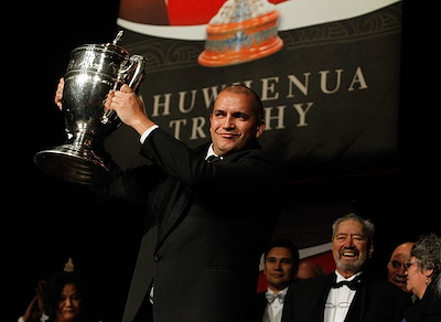 Chair Dion Maaka accepts the Ahuwhenua Trophy for Te Rua o Te Moko Ltd