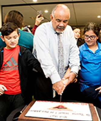 Māori Development Minister Te Ururoa Flavell cuts the 30th celebration cake.