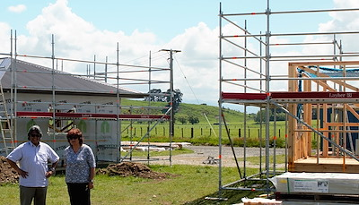 Henare Manaena and Mary Nunn, stand proudly in front of the new social housing development and infrastructure support that has started at Hurunui-o-Rangi Marae, 2017. Photo courtesy of Henare Manaena.