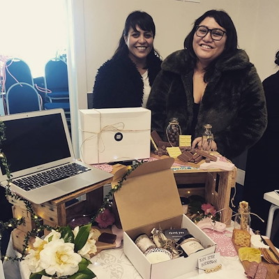Sisters Karla and Nicole Hogan with one of their gift boxes. The pair have taken part in PopUp Business School in Gisborne where they exhibited their business, three thirty three, at the school's trade show in June 2018. Photo credit Karla and Nicole Hogan.