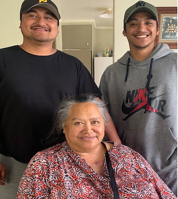 Legacy Clarke (left) and Kortez Gomez (right) with Nana Joann Clarke (Ngāti Tūwharetoa, Rauhato).
