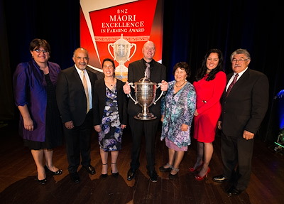 Mangaroa Station was presented with the 2015 Ahuwhenua Trophy BNZ Māori Excellence in Farming award. Barton and Nukuhia Hadfield are flanked by: Te Puni Kōkiri Chief Executive Michelle Hippolite and Māori Development Minister Hon Te Ururoa Flavell (left), and Te Puni Kōkiri staff (right) Ikaroa-Rāwhiti Regional Manager Mere Pohatu, Economic Wealth Manager Taria Tahana, and Kaitohu Ian Peters.