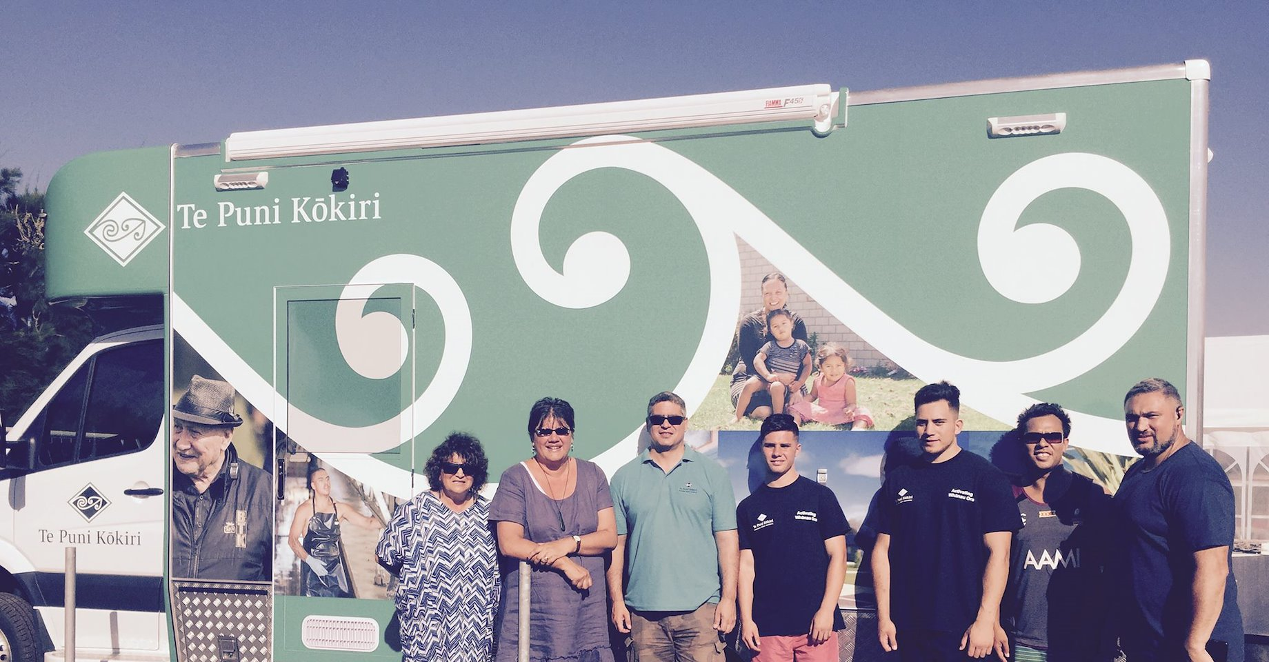 Michelle Hippolite, Toihautū | Chief Executive and Te Puni Kōkiri staff in front of the mobile service