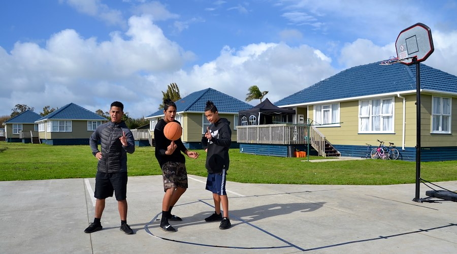 Rangatahi get to enjoy the play area at Kōhuhu papakāinga. He Korowai Trust relocated nine homes from Auckland to Kaitaia with a plan to have up to 18 homes on the papakāinga, planted 200 fruit trees, created a safe play area and built a puna reo. Photographer: Chevon Horsford