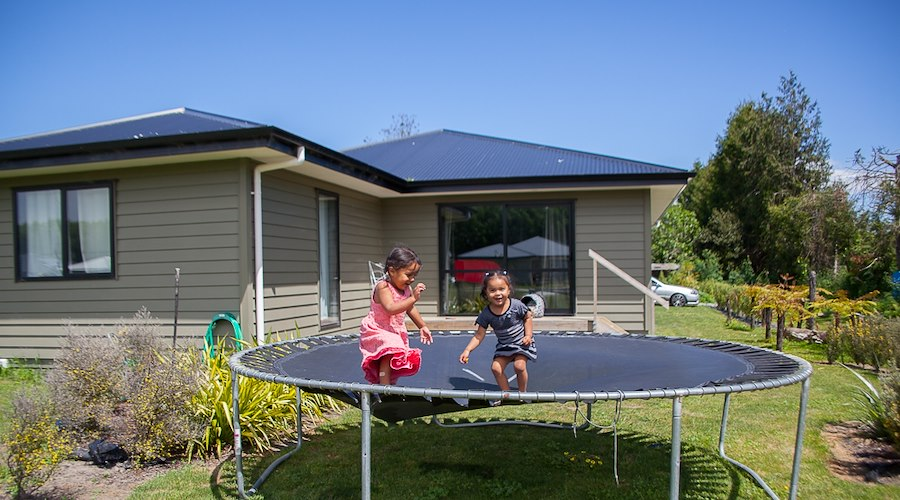 With the support of the Māori Housing Network led by Te Puni Kōkiri, the Aorangi Māori Trust Board are able to provide safe, warm and affordable homes for whānau. Pictured: Waipatu papakāinga residents, Taylor and Portlin Wilson, 2016.